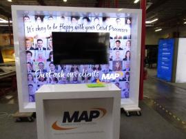 VK-1340 Custom Exhibit with LED Lightbox, Monitor Mount, Fabric Graphic, and MOD-1563 Reception Counter